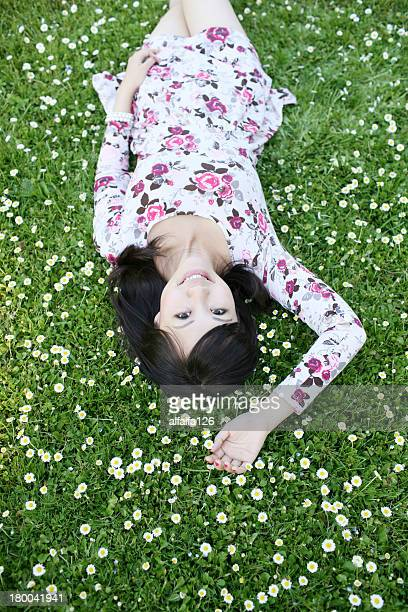 Young lady lying on the grass