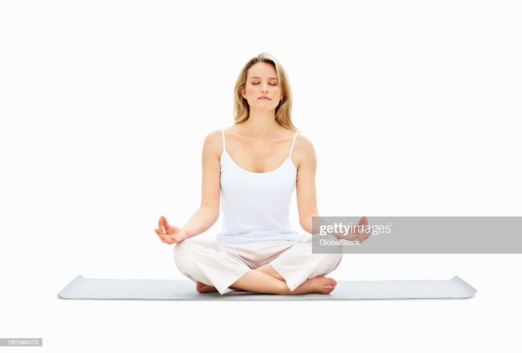 Young lady meditating in lotus position over white