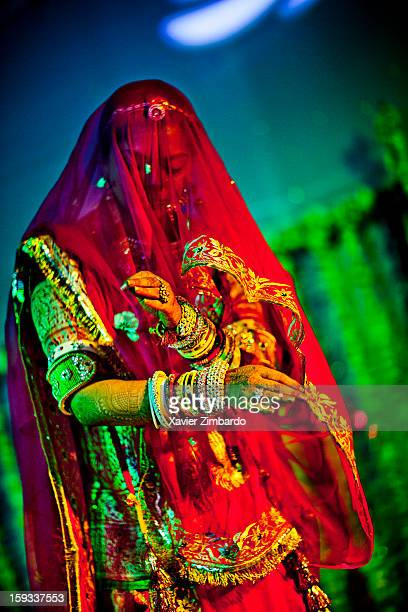 A young lady of the family sings and dances for the guests during the 'Sangeet' on February 17 2011 at Jhala House in Pali Marwar Rajasthan India