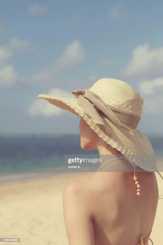 Young lady overlooking the ocean on a fine day. : Stock Photo