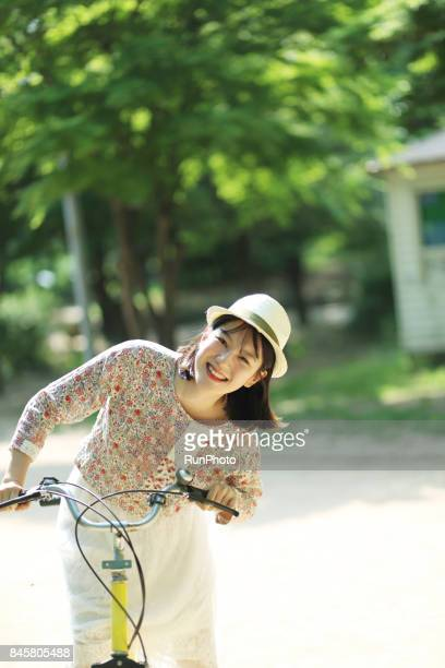 young lady riding a bicycle and having a fun face
