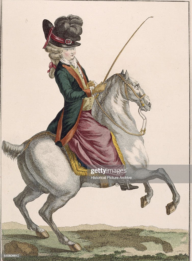 A young lady riding a horse dressed in dark green and mauve riding habit