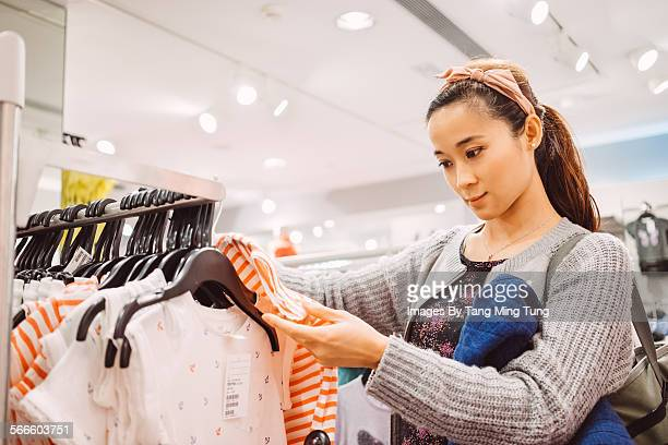 Young lady shopping in department store