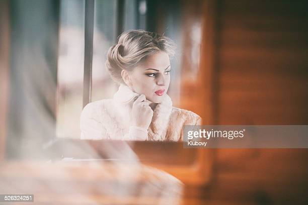 Young lady sitting in a train wagon