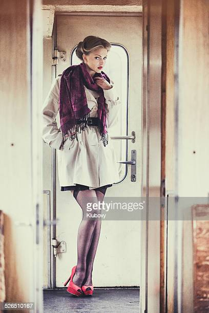 Young lady standing in a train wagon