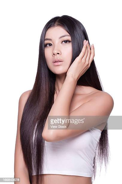 Young lady touching silky hair