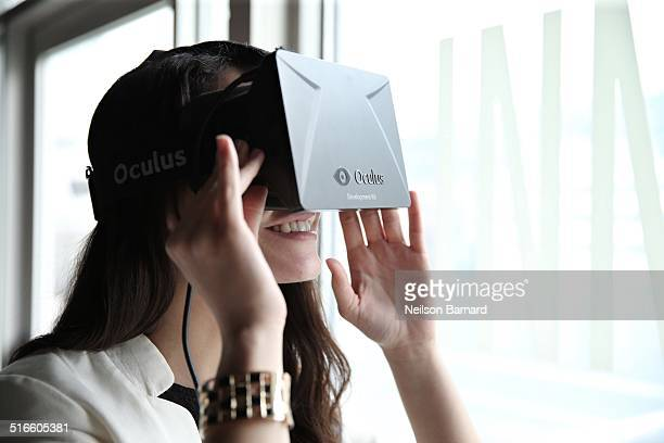 A young lady tries out the Oculus Rift wearable tech development kit during the NBC Innovation Summit 20