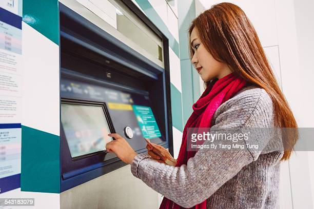 Young Lady using an ATM machine