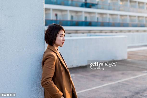 Young lady waiting in outdoor parking lot