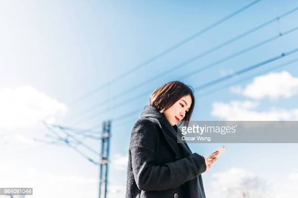 Young lady waiting train on platform