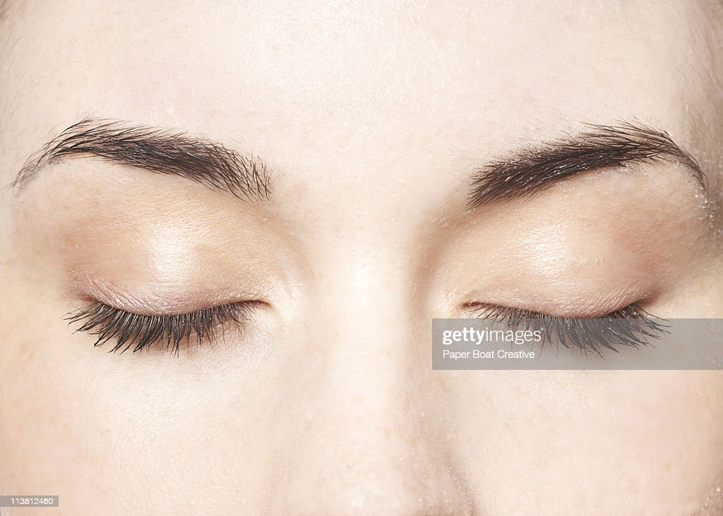 Young lady with her eyes closed, close up