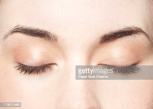 Young lady with her eyes closed, close up : Stock Photo