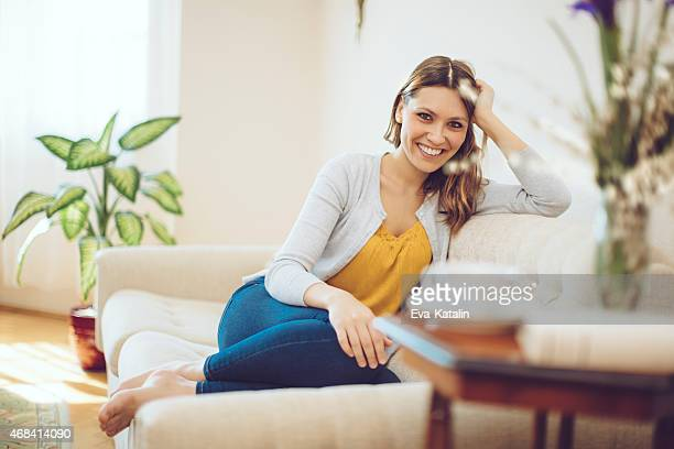Young latin woman relaxing at home and looking at camera