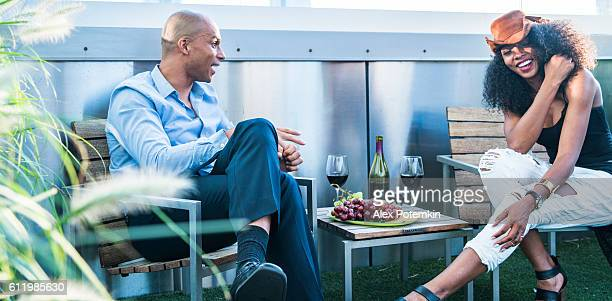 Young Latino couple have dinner and dating on rooftop