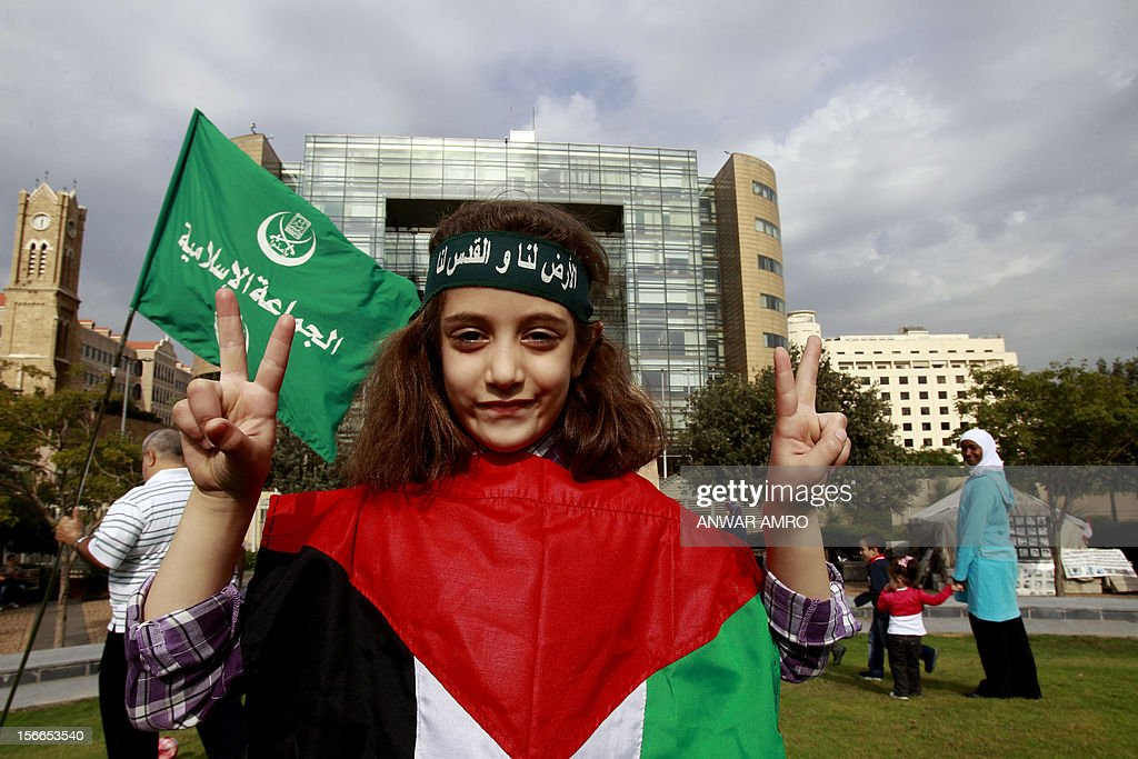 A young Lebanese supporter of the Sunni Muslim Jamaa Islamiya group flashes the victory signs during a rally against the ongoing attack on Gaza outside the offices of the United Nations Economic and Social Commission for Western Asia (ESCWA) in Lebanese capital Beirut, on November 18, 2012. The death toll in Gaza rose to 52 since the start of the conflict, with more than 460 injured, the Palestinian health ministry said. AFP PHOTO / ANWAR AMRO