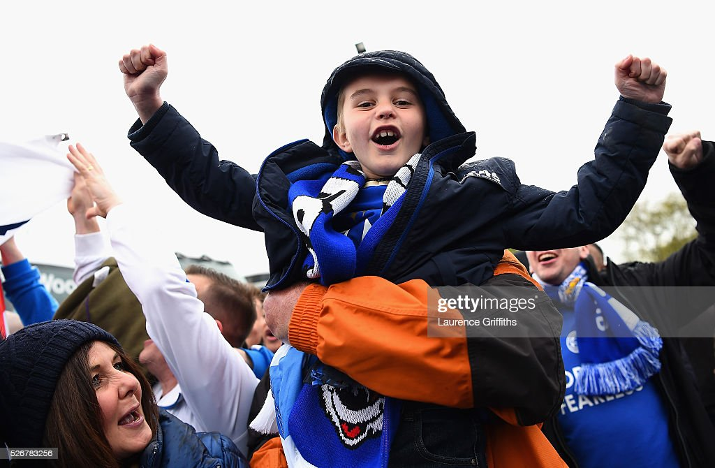 A young Leicester City fan cheers outside the ground prior to the Barclays Premier League match between Manchester United and Leicester City at Old Trafford on May 1, 2016 in Manchester, England.