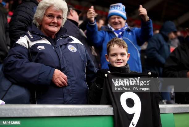 A young Leicester City fan in the stands gets Jamie Vardy's match shirt after the Premier League match at the Liberty Stadium Swansea