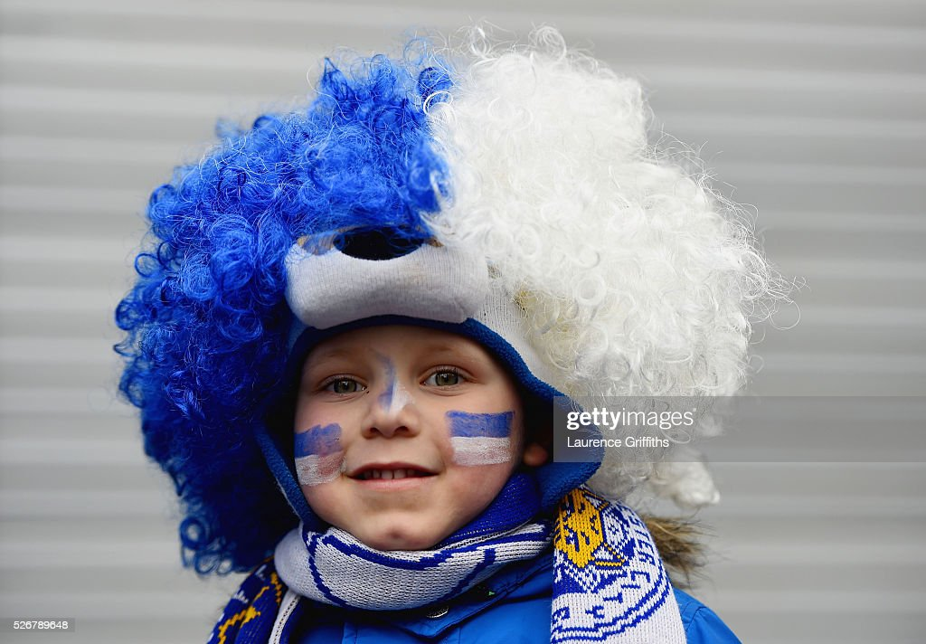 A young Leicester City fan poses prior to the Barclays Premier League match between Manchester United and Leicester City at Old Trafford on May 1, 2016 in Manchester, England.