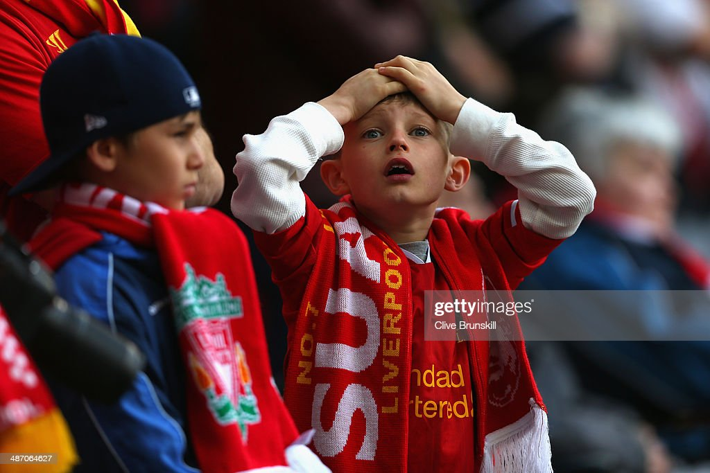 A young Liverpool fan reacts during the Barclays Premier League match between Liverpool and Chelsea at Anfield on April 27, 2014 in Liverpool, England.