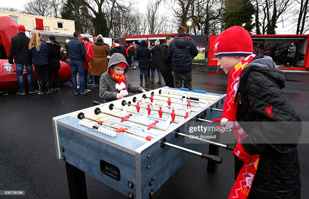 Young Liverpool supporters play at a football table prior to the Barclays Premier League match between Liverpool and Sunderland at Anfield on February 6, 2016 in Liverpool, England.