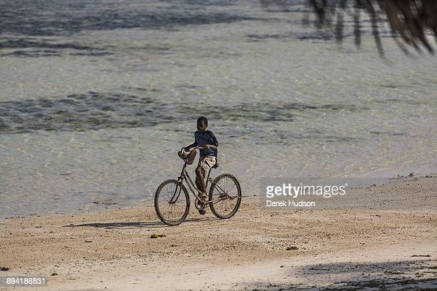 A young local boy rides a bicycle on the beach at Msambweni Msambweni is in Kwale county 47 kilometres north east of the Tanzanian border town of...