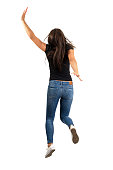 Young long hair woman jumping or running away. Backside view. Full body length isolated over white background.