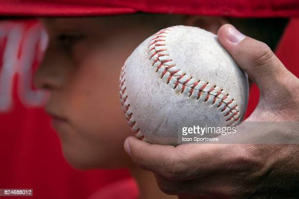 A young Los Angeles Angels of Anaheim fan waits to get autographs as his father holds a ball before the regular season MLB game between the Los...