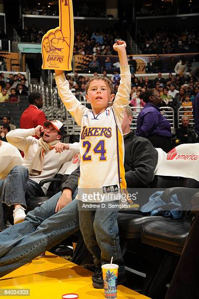 A young Los Angeles Lakers fan cheers his team on against the Minnesota Timberwolves at Staples Center on December 14 2008 in Los Angeles California...
