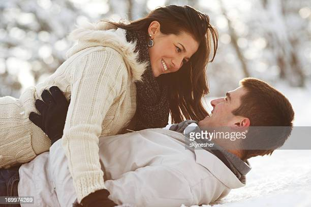Young love couple enjoying in a romantic winter day.