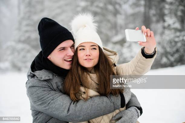 Young love couple taking selfie with phone