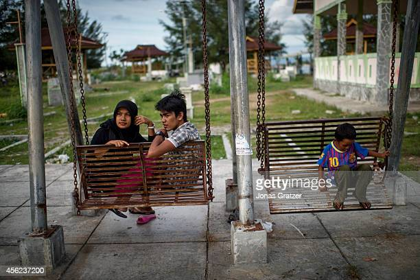 Young lovers meet in the park at dusk after the religious Sharia Police have finished their patrol for the day In the autonomous region of Aceh there...