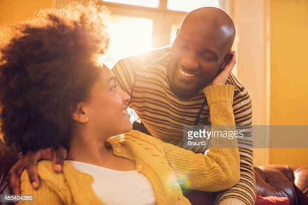 Young loving African American couple communicating at home.