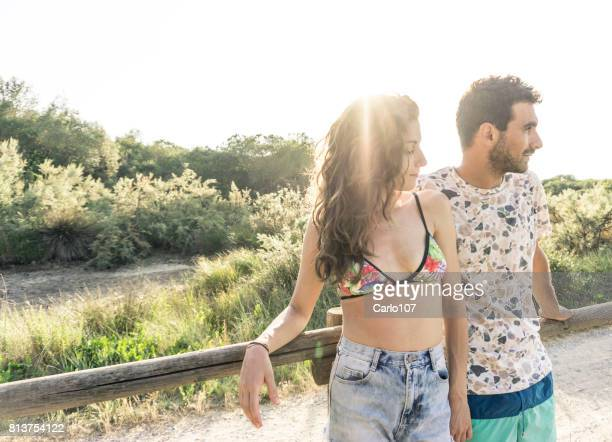 Young loving couple embracing outdoors in Tuscany