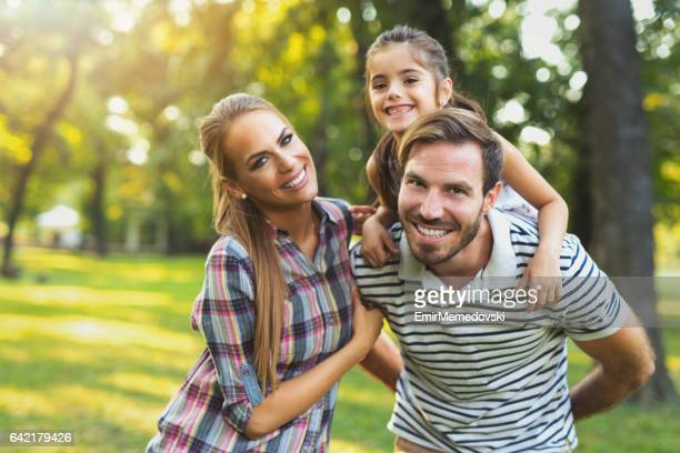 Young loving family having fun in the park.