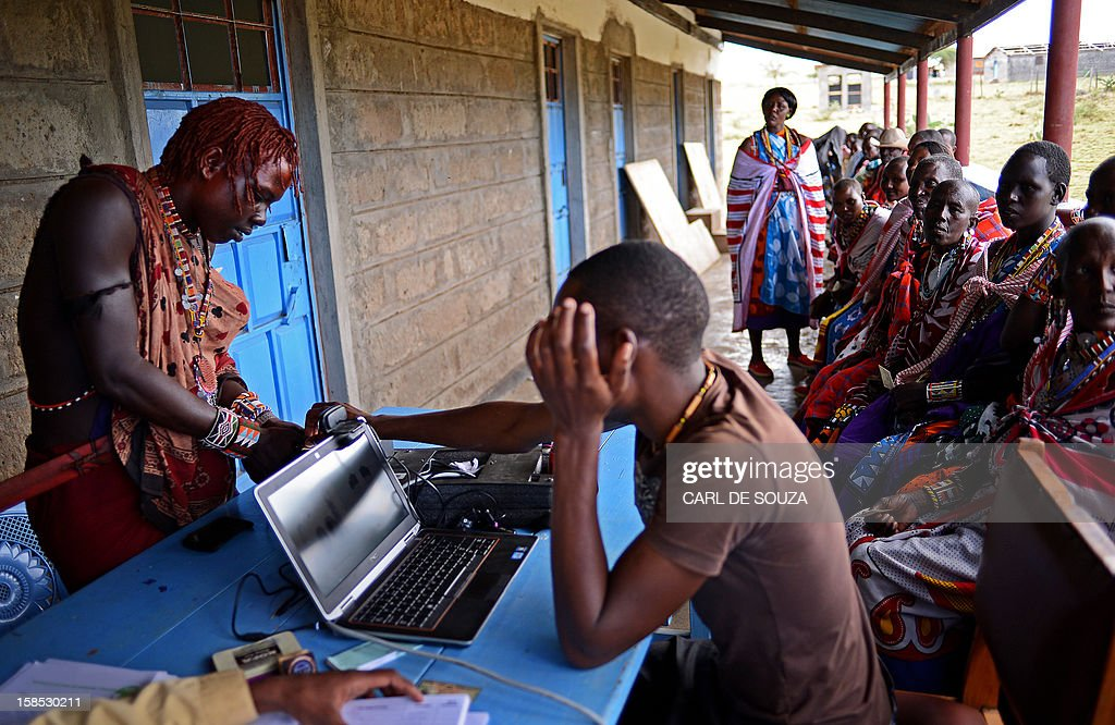 A young Maasai man registers to vote in the village of Olgumi in Kajiado County West on December 18, 2012. Today marked the last day for Kenyans to register to vote and voter registration centres across the country saw a marked increase in attendance of voters who were desperate to register at the last minute. The Independent Electoral and Boundaries Commission (IEBC) has taken biometric computer equipment to populations in remote tribal areas in order to ensure that the chance of voting fraud is decreased for the country's forthcoming elections in March 2013. AFP PHOTO/Carl de Souza