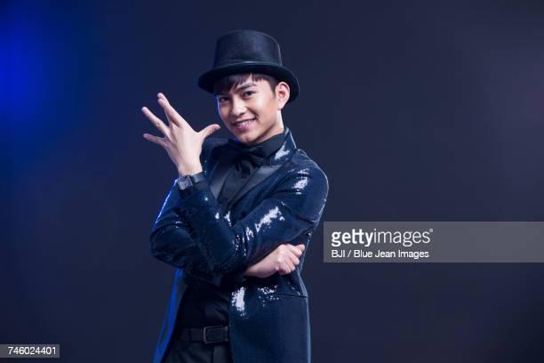 Young magician performing magic trick