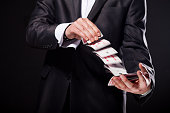 Young magician showing tricks using cards from deck. Close up