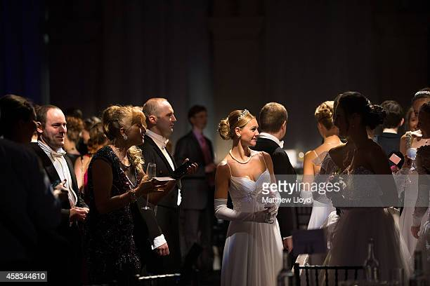 Young mainly Russian debutantes alongside others from across the world assemble in Old Billingsgate Hall before their first performance on November 2...