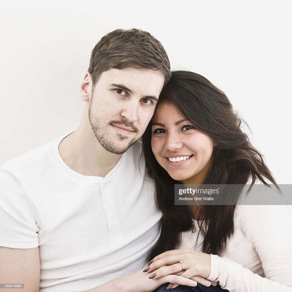 Young male and female couple celebrate engagement : Stock Photo