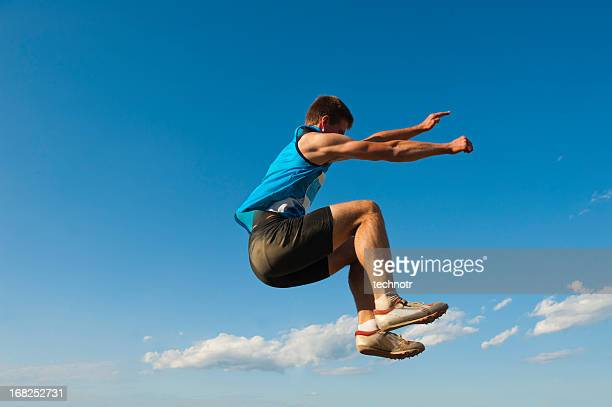 Young male athlete at long jump