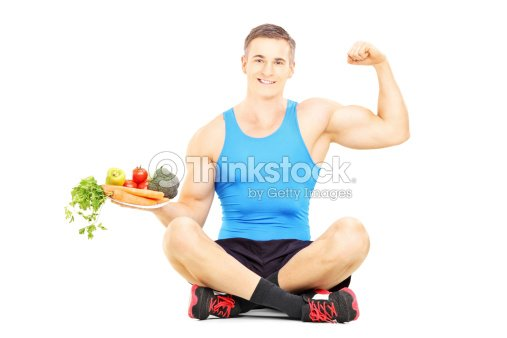Joven atleta masculino retención de placa completo de verduras : Foto de stock