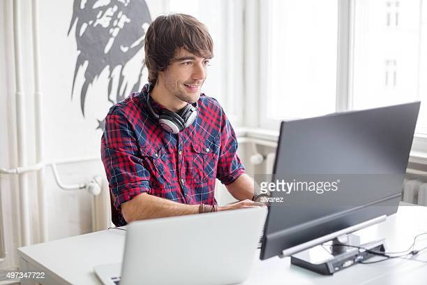 Young male computer programmer in office