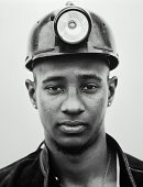Young male construction worker, close-up (B&W)