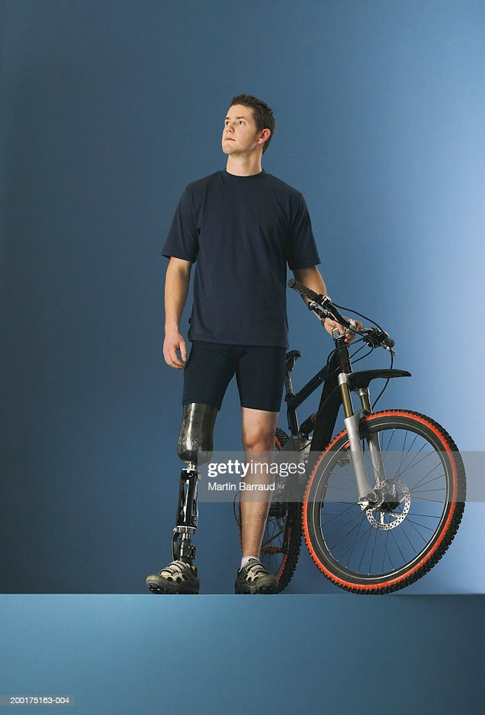 Young male cyclist with prosthetic leg