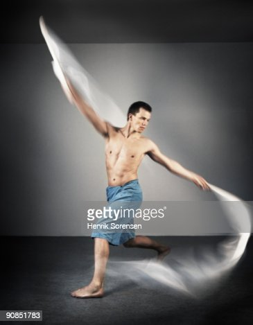 young male dancer with pennants : Stock Photo