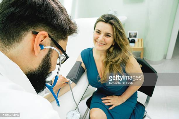 Young Male Doctor Measuring Blood Pressure