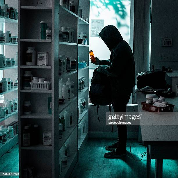 A young male drug addict stealing prescriptions.