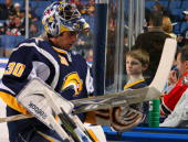 A young male fan watches Ryan Miller of the Buffalo Sabres leave the ice before playing the Washington Capitals on December 9 2009 at HSBC Arena in...