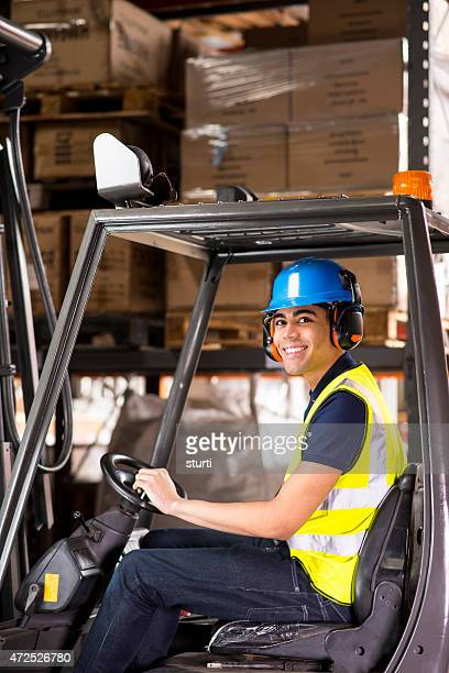 young male forklift driver in a warehouse