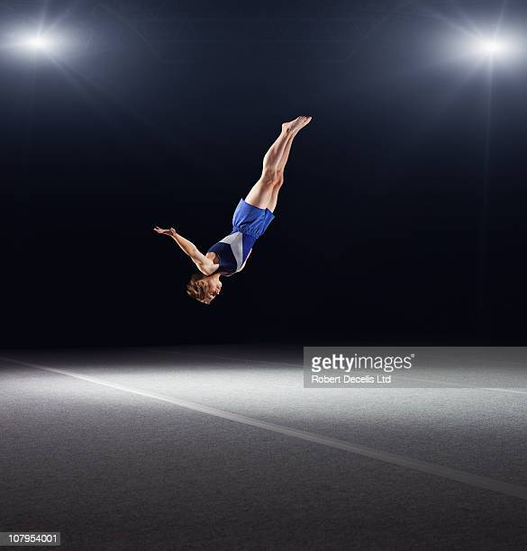Young male gymnast performing floor routine